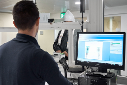 The fingerprints of an asylum seeker appear on a computer screen and are checked by a SEM staff member.
